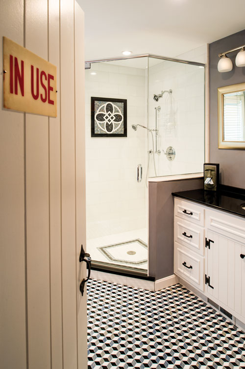 A bathroom with tile was inspired by a tumbling block pattern the owners saw at the Getty Villa near Los Angeles