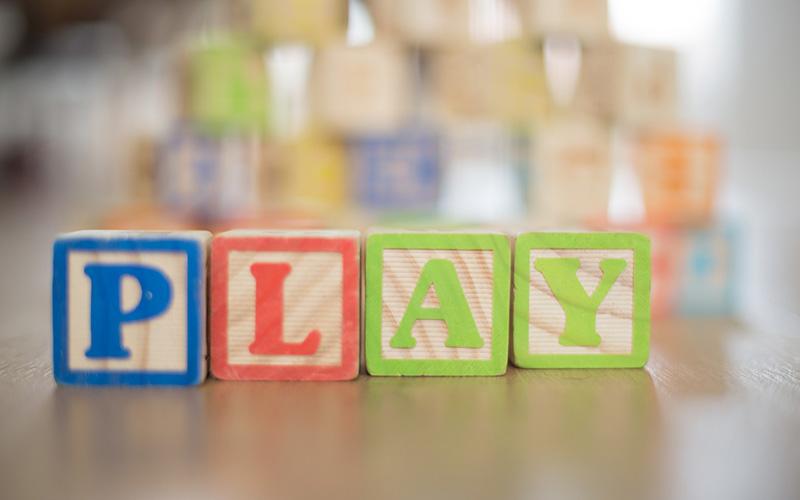 """Blocks spelling the word """"play"""""""