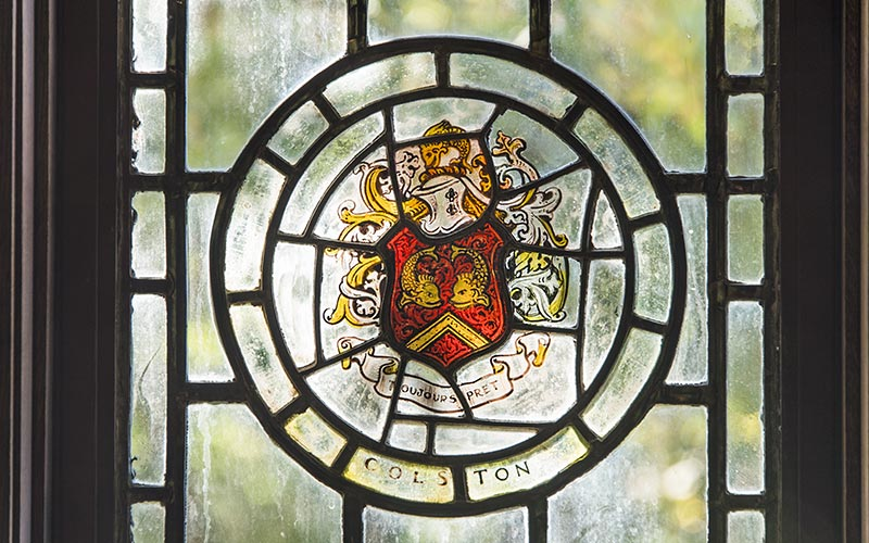 Glass window with Colston crest