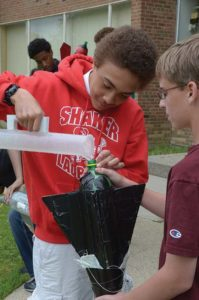 Students performing a science experiment at Shaker Middle School.