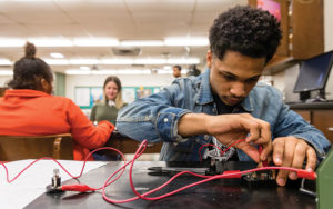 Shaker High student working on electronics