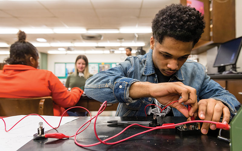 African American student working with electronics at Shaker Heights High School