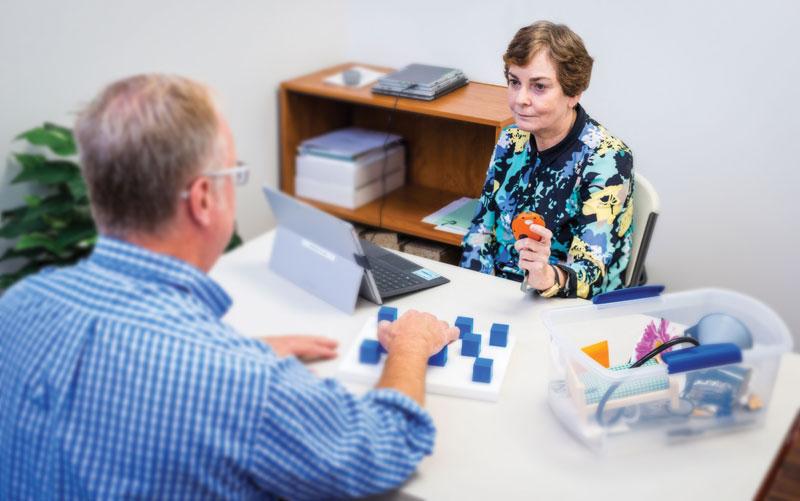 Dr. Deborah Gould evaluating a patient.