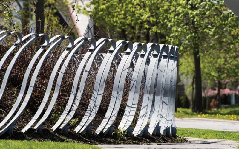 A public art installation that serves as a fence for an orchard in Shaker Heights
