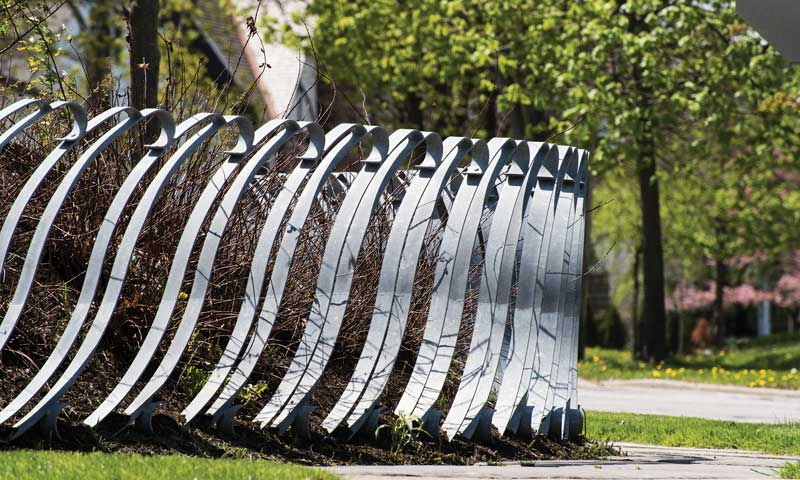 Public art serving a functional purpose as a fence for Shaker's apple orchard