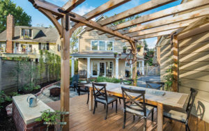 Outdoor dining area of Ramsey's remodeled home
