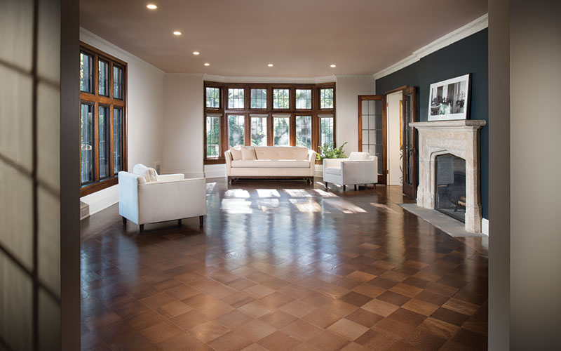 Restored living room of green 1920s-era Shaker Heights home.