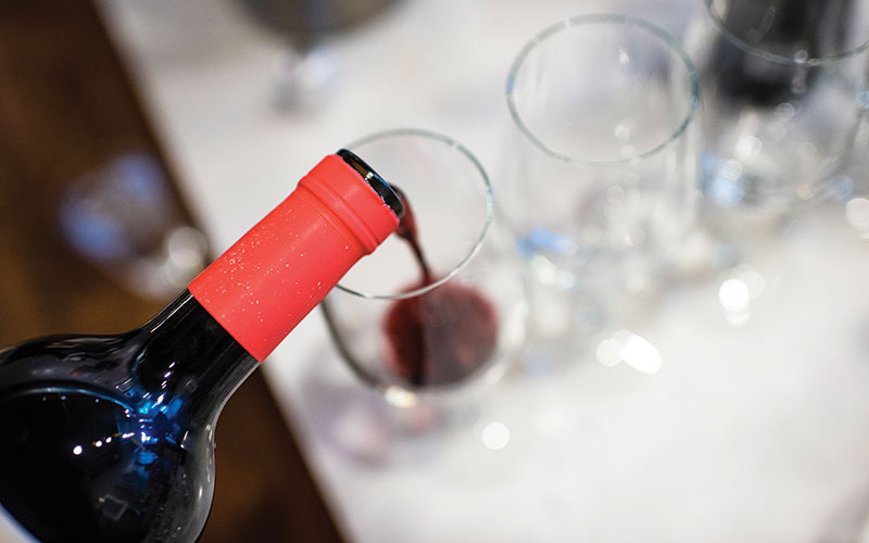 Close up of red wine being poured into a glass