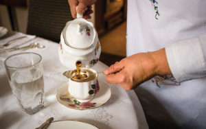 Barbara Glauser of the Rolling Tea Cart prepares a cup of tea.