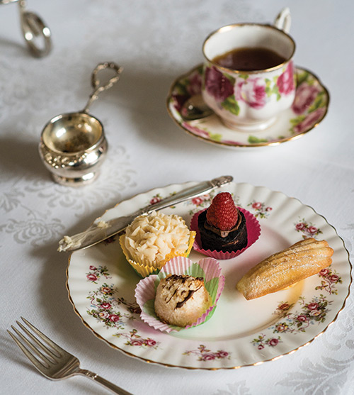 Scone and other sweets on a plate.