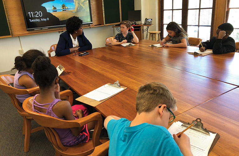 Onaway fourth-grade students interview Shaker Heights Schools Chief of Staff Dr. Marla J. Robinson for their IB Exhbition project on bullying.