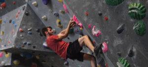 Man climbing at climbing gym