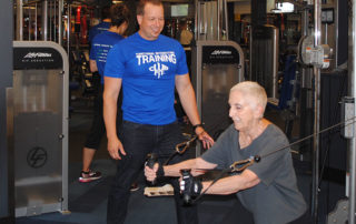 Philip Stotter, owner of Club Fit, working with a client