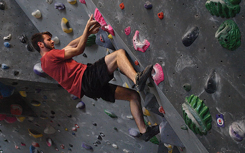 Many climbing at indoor gym