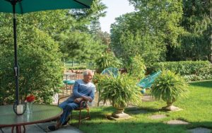 Barton Brunswick on his patio overlooking the Shaker Heights Country Club's golf course.