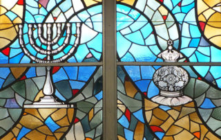 The original stained glass windows in the Shaker-Lee Synagogue