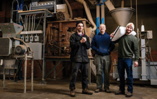 At the Haus Malts facility, from left: Chris Eaton, Craig Martahus, Andrew Martahus