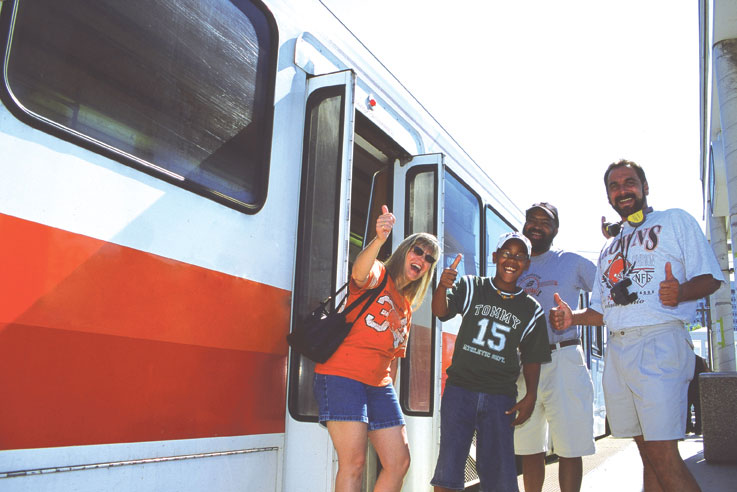 Passengers excited to board the Rapid to ride to sports event