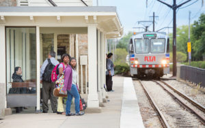 Passengers at the Shaker Square Rapid stop
