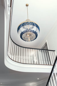 A beaded chandelier in foyer of Midkiff home