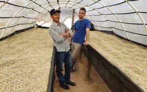 Mike Vehar meeting with a coffee grower in Honduras