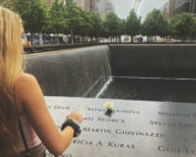 Leiken places a flower at the 9/11 Memorial in New York City