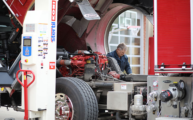 Shaker Heights Fire Dept. mechanic Chuck Bates at work on a fire truck