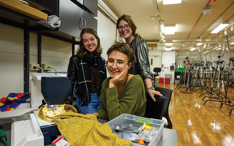Lane Murray, Louise Spadoni and Rachel Raddock purchase clothing from thrift stores, embellish them with this special sewing machine, and resell the items for their business, CyCLE Clothing. One hundred percent of the profits go to charity.