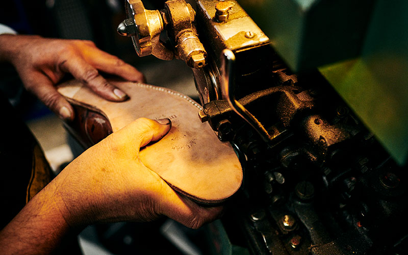 Carlos Gomez repairing a shoe