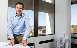 Joe Comar of The Mannik & Smith Group in his Tower East office