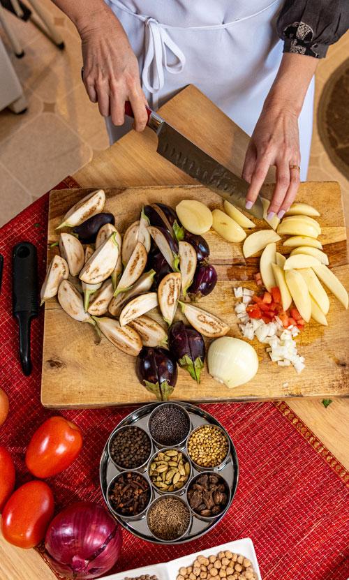 Sahar Rizvi chopping eggplant