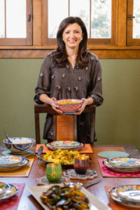 Sahar Rizvi at the dining table with prepared foods