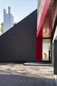Closer view of red front door