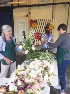 Volunteers arranging flowers