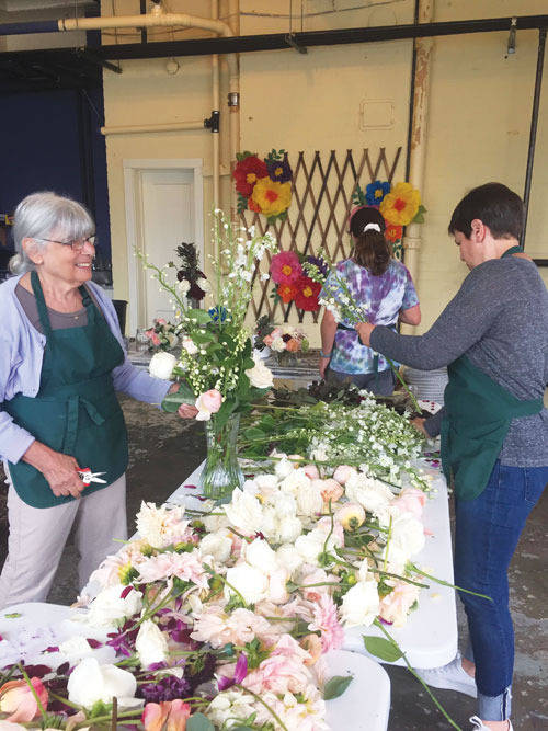 Volunteers arranging flowers