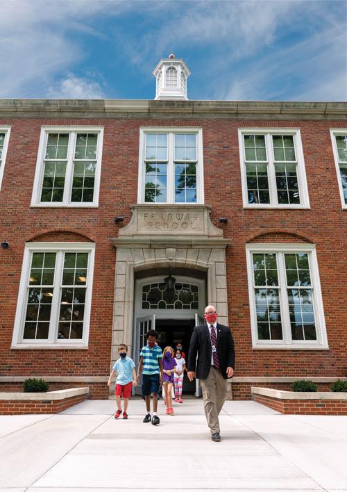 Principal Chris Hayward and students outside Fernway School.