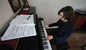 Max Carroll at the piano